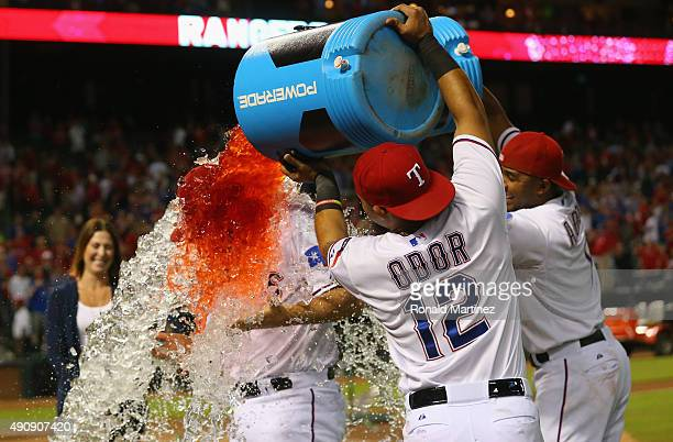 Rougned Odor and Elvis Andrus of the Texas Rangers douse Shawn Tolleson after beating the Los Angeles Angels and advancing to the postseason at Globe...