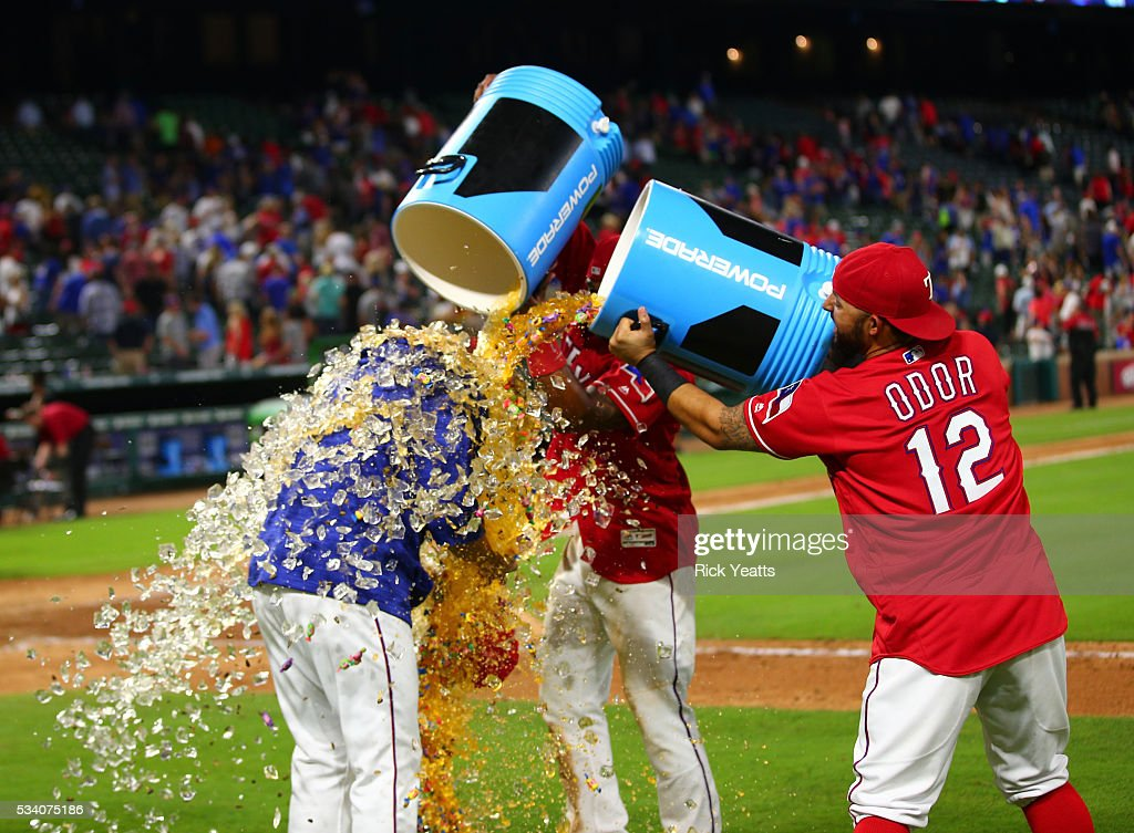 <a gi-track='captionPersonalityLinkClicked' href=/galleries/search?phrase=Rougned+Odor&family=editorial&specificpeople=12505074 ng-click='$event.stopPropagation()'>Rougned Odor</a> #12 and <a gi-track='captionPersonalityLinkClicked' href=/galleries/search?phrase=Elvis+Andrus&family=editorial&specificpeople=4845974 ng-click='$event.stopPropagation()'>Elvis Andrus</a> #1 of the Texas Rangers dump Gatorade on Martin Perez #33, the winning pitcher against the Los Angeles Angels of Anaheim at Global Life Park in Arlington on May 24, 2016 in Arlington, Texas.