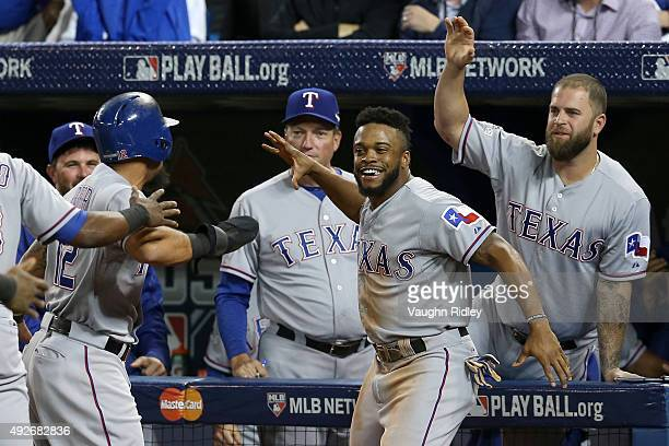 Rougned Odor celebrates with Delino DeShields of the Texas Rangers after Odor comes in to score after the throw by Russell Martin of the Toronto Blue...