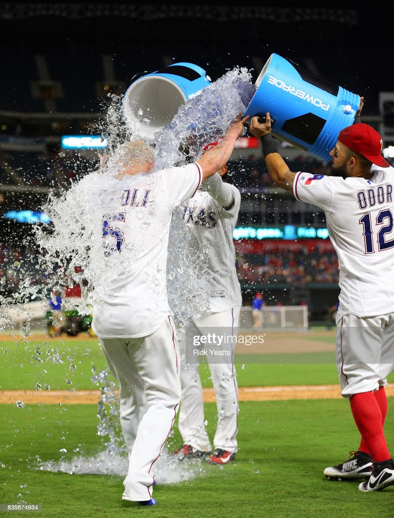 Rougned Odor #12 of the Texas Rangers and Elvis Andrus #1 dump the coolers on Mike Napoli #5 in celebration of winning the game against the Chicago White Sox at Globe Life Park in Arlington on August 19, 2017 in Arlington, Texas.