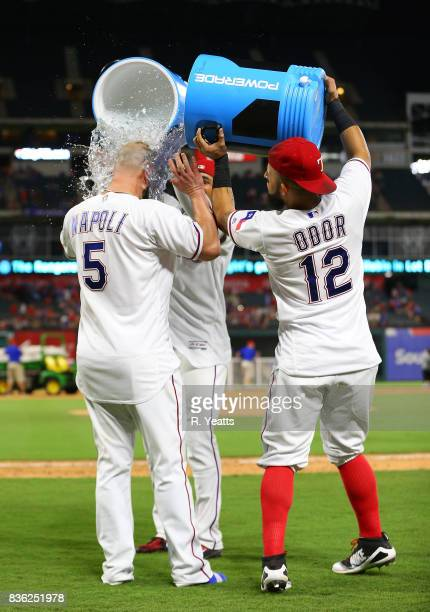 Rougned Odor of the Texas Rangers and Elvis Andrus dump the coolers on Mike Napoli in celebration of winning the game against the Chicago White Sox...