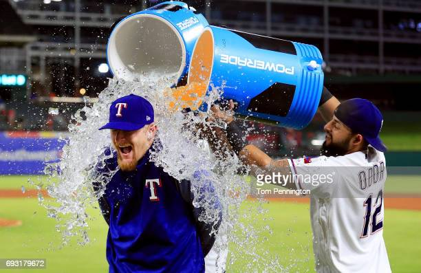 Rougned Odor of the Texas Rangers and Elvis Andrus of the Texas Rangers soak Dillon Gee of the Texas Rangers with Powerade and water after earning...