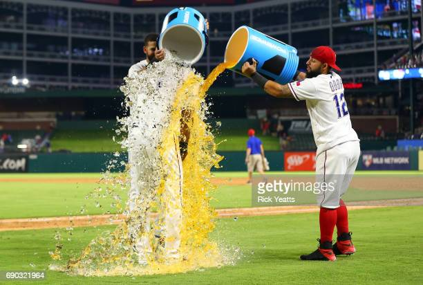 Rougned Odor of the Texas Rangers and Nomar Mazara dump the cooler on Elvis Andrus at the conclusion of the game against the Tampa Bay Rays at Globe...