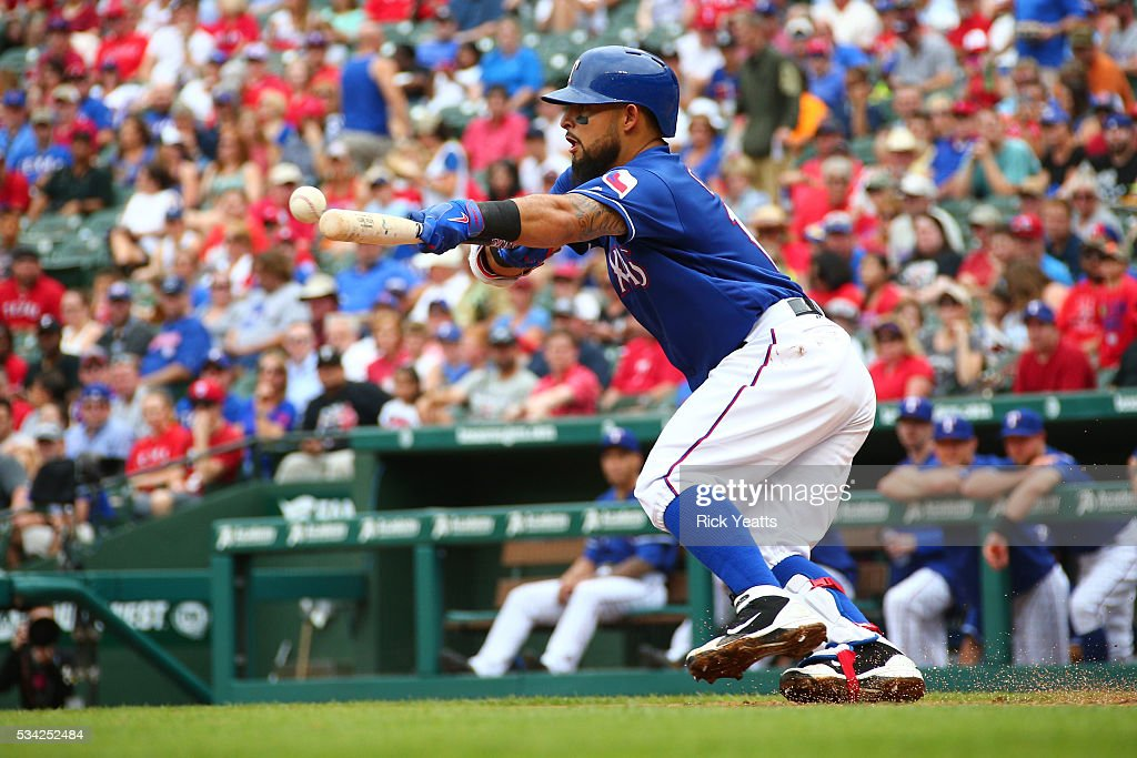 <a gi-track='captionPersonalityLinkClicked' href=/galleries/search?phrase=Rougned+Odor&family=editorial&specificpeople=12505074 ng-click='$event.stopPropagation()'>Rougned Odor</a> #12 of the Texas Rangers bunts for a base hit in the first inning against the Los Angeles Angels of Anaheim at Global Life Park in Arlington on May 25, 2016 in Arlington, Texas.