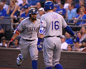 Rougned Odor of the Texas Rangers celebrates his home run with Ryan Rua in the fourth inning against the Kansas City Royals at Kauffman Stadium on...
