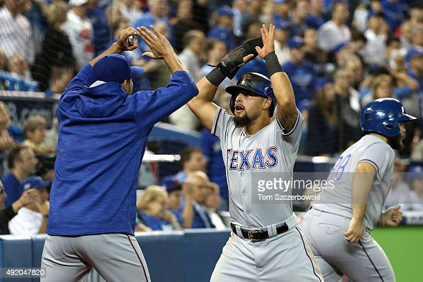 Rougned Odor of the Texas Rangers celebrates scoring the go ahead run in the 14th inning against the Toronto Blue Jays during game two of the...