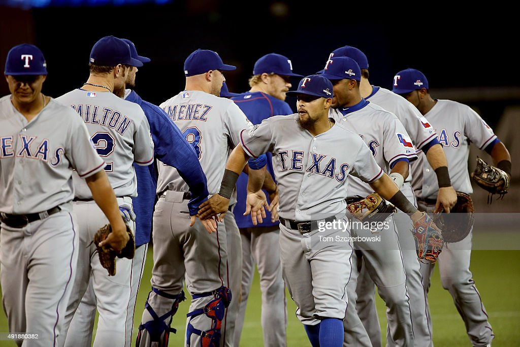 Rougned Odor of the Texas Rangers celebrates with his teammates after defeating the Toronto Blue Jays after game one of the American League Division...