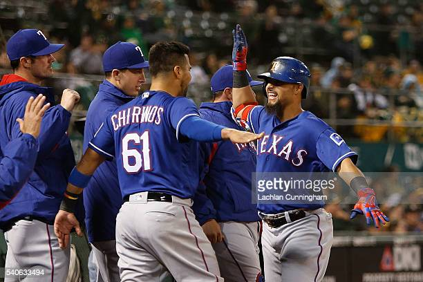 Rougned Odor of the Texas Rangers celebrates with Robinson Chirinos of the Texas Rangers after hitting a solo home run in the eighth inning against...