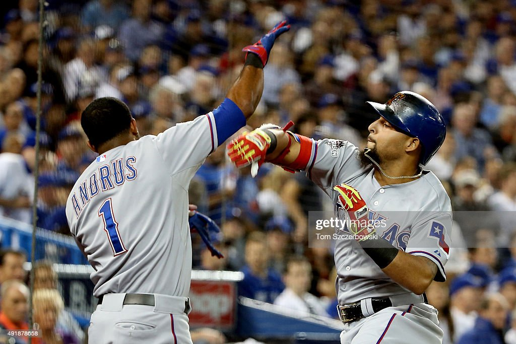 Rougned Odor #12 of the Texas Rangers celebrates with teammate Elvis Andrus #1 after scoring a solo home run against David Price #14 of the Toronto Blue Jays in the seventh inning during game one of the American League Division Series at Rogers Centre on October 8, 2015 in Toronto, Ontario, Canada.