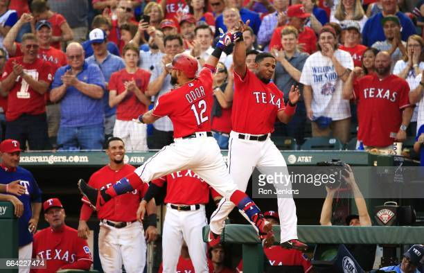 Rougned Odor of the Texas Rangers celebrates with teammate Elvis Andrus after Odor hit a solo home run against the Cleveland Indians in the second...