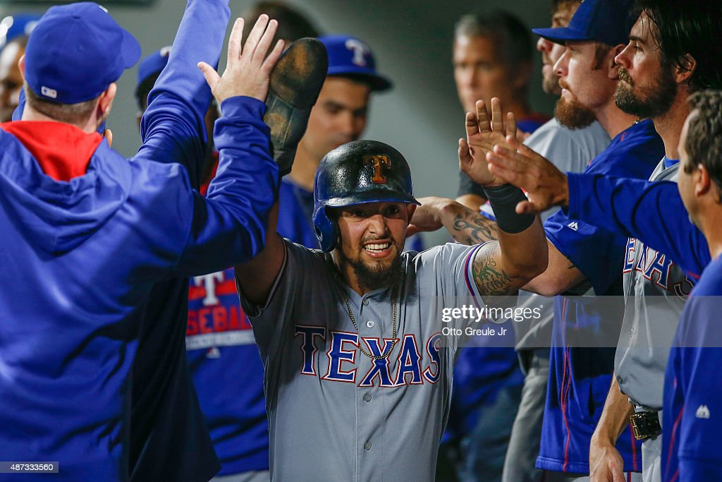 Rougned Odor of the Texas Rangers celebrates with teammates after scoring in the sixth inning against the Seattle Mariners at Safeco Field on...