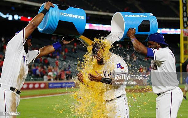 Rougned Odor of the Texas Rangers center is doused with sports drink by Elvis Andrus left and Hanser Alberto in celebration of winning 21 over the...