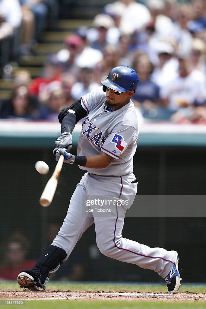 <a gi-track='captionPersonalityLinkClicked' href=/galleries/search?phrase=Rougned+Odor&family=editorial&specificpeople=12505074 ng-click='$event.stopPropagation()'>Rougned Odor</a> #73 of the Texas Rangers drives in a run with a sacrifice fly in the second inning of the game against the Cleveland Indians at Progressive Field on August 3, 2014 in Cleveland, Ohio.