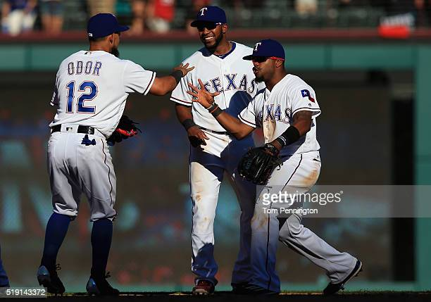 Rougned Odor of the Texas Rangers Elvis Andrus of the Texas Rangers and Delino DeShields of the Texas Rangers celebrate after beating the Seattle...
