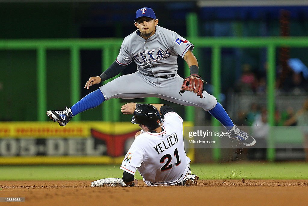 <a gi-track='captionPersonalityLinkClicked' href=/galleries/search?phrase=Rougned+Odor&family=editorial&specificpeople=12505074 ng-click='$event.stopPropagation()'>Rougned Odor</a> #12 of the Texas Rangers forces out <a gi-track='captionPersonalityLinkClicked' href=/galleries/search?phrase=Christian+Yelich&family=editorial&specificpeople=9527291 ng-click='$event.stopPropagation()'>Christian Yelich</a> #21 of the Miami Marlins during a game at Marlins Park on August 19, 2014 in Miami, Florida.