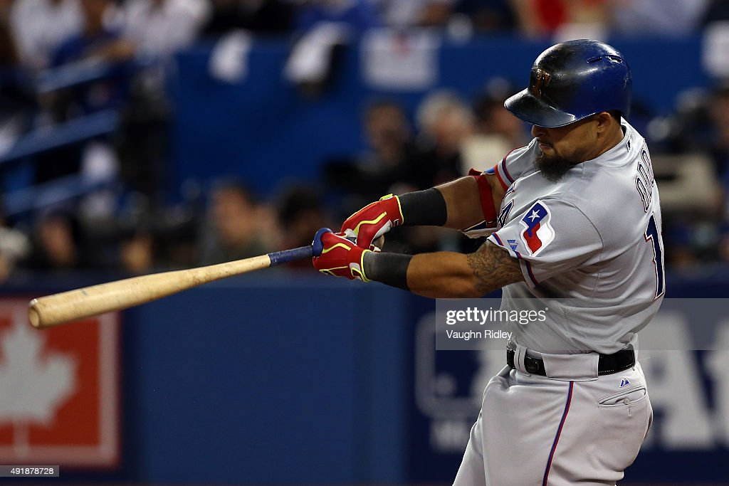 Rougned Odor #12 of the Texas Rangers hits a solo home run against David Price #14 of the Toronto Blue Jays in the seventh inning during game one of the American League Division Series at Rogers Centre on October 8, 2015 in Toronto, Ontario, Canada.