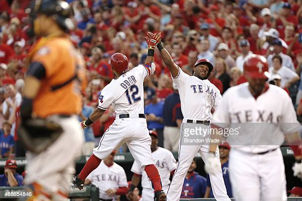 Rougned Odor of the Texas Rangers is congratulated by Elvis Andrus after hitting a two run home run during the first inning of a baseball game...