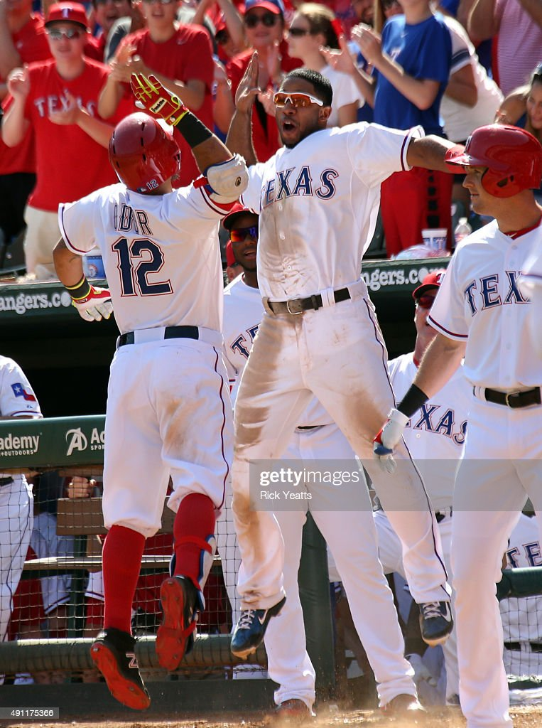 <a gi-track='captionPersonalityLinkClicked' href=/galleries/search?phrase=Rougned+Odor&family=editorial&specificpeople=12505074 ng-click='$event.stopPropagation()'>Rougned Odor</a> #12 of the Texas Rangers is congratulated by <a gi-track='captionPersonalityLinkClicked' href=/galleries/search?phrase=Elvis+Andrus&family=editorial&specificpeople=4845974 ng-click='$event.stopPropagation()'>Elvis Andrus</a> #1 for hitting a solo home run in the seventh inning against the Los Angeles Angels of Anaheim at Rangers Global Life Park in Arlington on October 3, 2015 in Arlington, Texas.