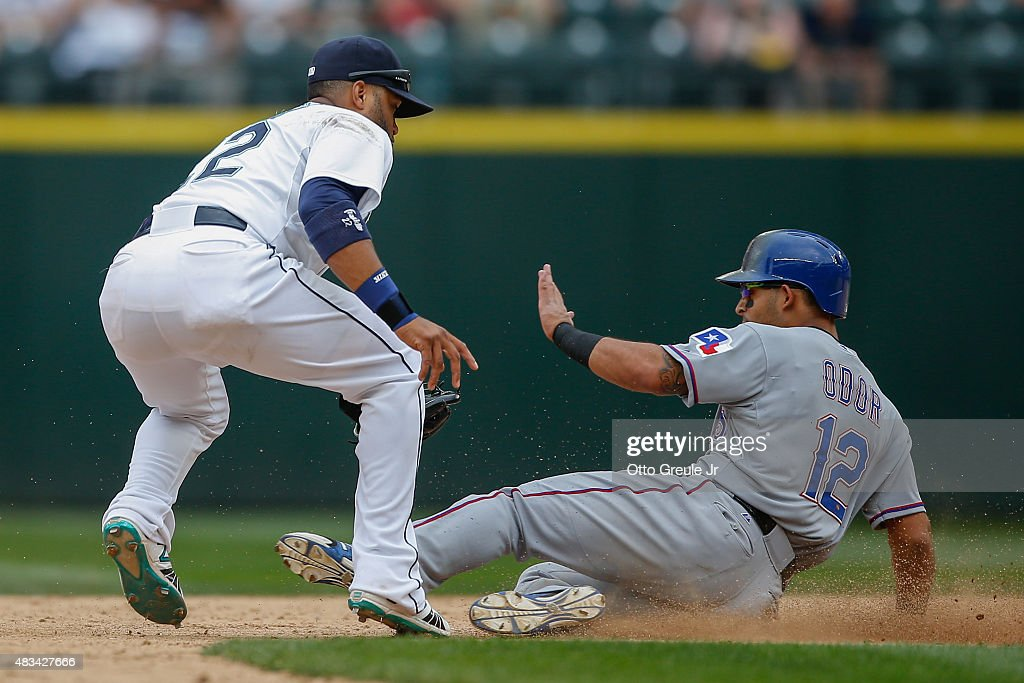 Rougned Odor #12 of the Texas Rangers is tagged out on a steal attempt by second baseman Robinson Cano #22 of the Seattle Mariners in the ninth inning at Safeco Field on August 8, 2015 in Seattle, Washington.