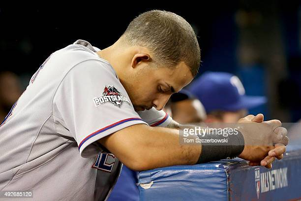 Rougned Odor of the Texas Rangers looks on from the dugout in the ninth inning as the Rangers take on the Toronto Blue Jays in game five of the...