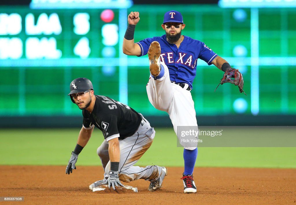 Rougned Odor #12 of the Texas Rangers makes the out on Yolmer Sanchez throwing to first for the double play in the fourth inning at Globe Life Park in Arlington on August 18, 2017 in Arlington, Texas.