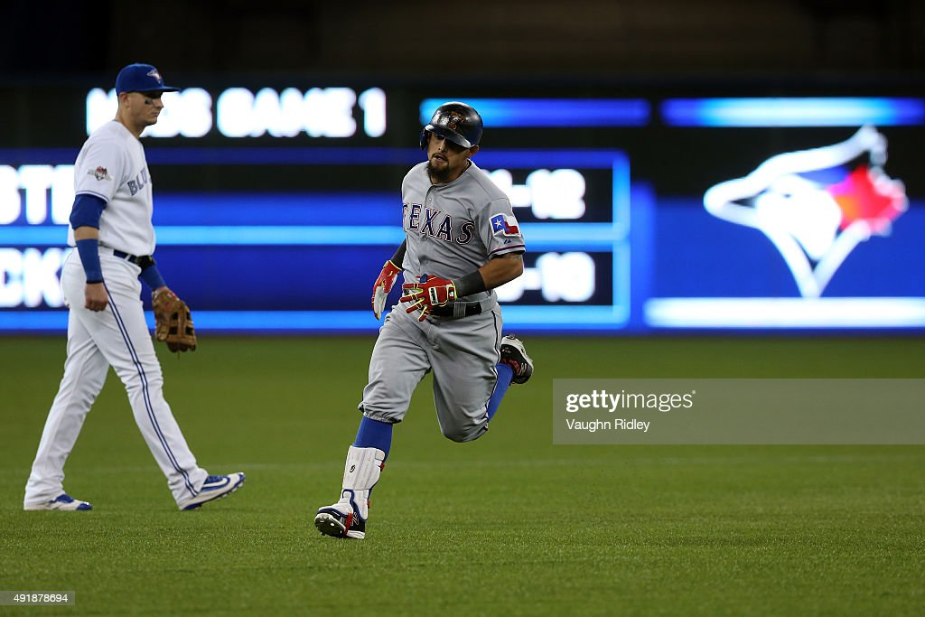 Rougned Odor #12 of the Texas Rangers rounds the bases after scoring a solo home run against David Price #14 of the Toronto Blue Jays in the seventh inning during game one of the American League Division Series at Rogers Centre on October 8, 2015 in Toronto, Ontario, Canada.