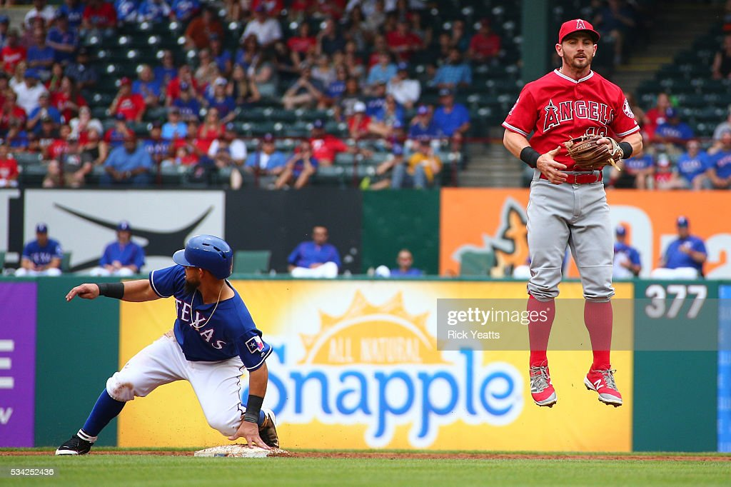 <a gi-track='captionPersonalityLinkClicked' href=/galleries/search?phrase=Rougned+Odor&family=editorial&specificpeople=12505074 ng-click='$event.stopPropagation()'>Rougned Odor</a> #12 of the Texas Rangers slides in safe and advancing to third base on a over throw to <a gi-track='captionPersonalityLinkClicked' href=/galleries/search?phrase=Johnny+Giavotella&family=editorial&specificpeople=7512348 ng-click='$event.stopPropagation()'>Johnny Giavotella</a> #12 of the Los Angeles Angels of Anaheim at Global Life Park in Arlington on May 25, 2016 in Arlington, Texas.