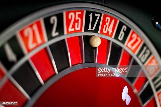 A roulette is displayed at a booth of the Global Gaming Expo Asia in the worlds biggest gambling hub of Macau on May 20 2014 The threeday fair of...