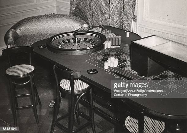 Roulette table and gambling chips at a 'swank gambling place' 18E 65th Street that was raided by the police 1940 New York United States Photo by...