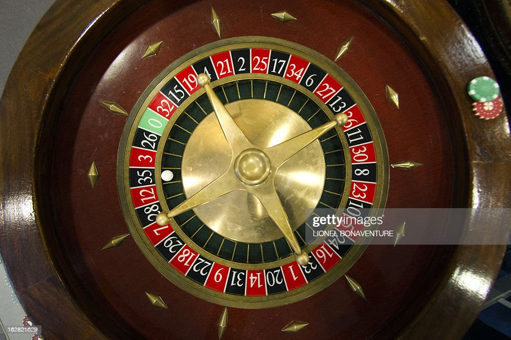 A roulette table is pictured in the Cerus Casino Academy, a school for croupiers in Paris, on February 27, 2013. AFP PHOTO / LIONEL BONAVENTURE