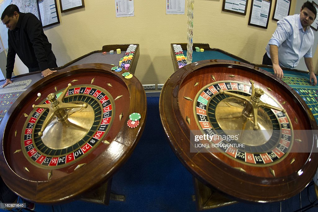 Roulette tables are pictured in the Cerus Casino Academy, a school for croupiers in Paris, on February 27, 2013.