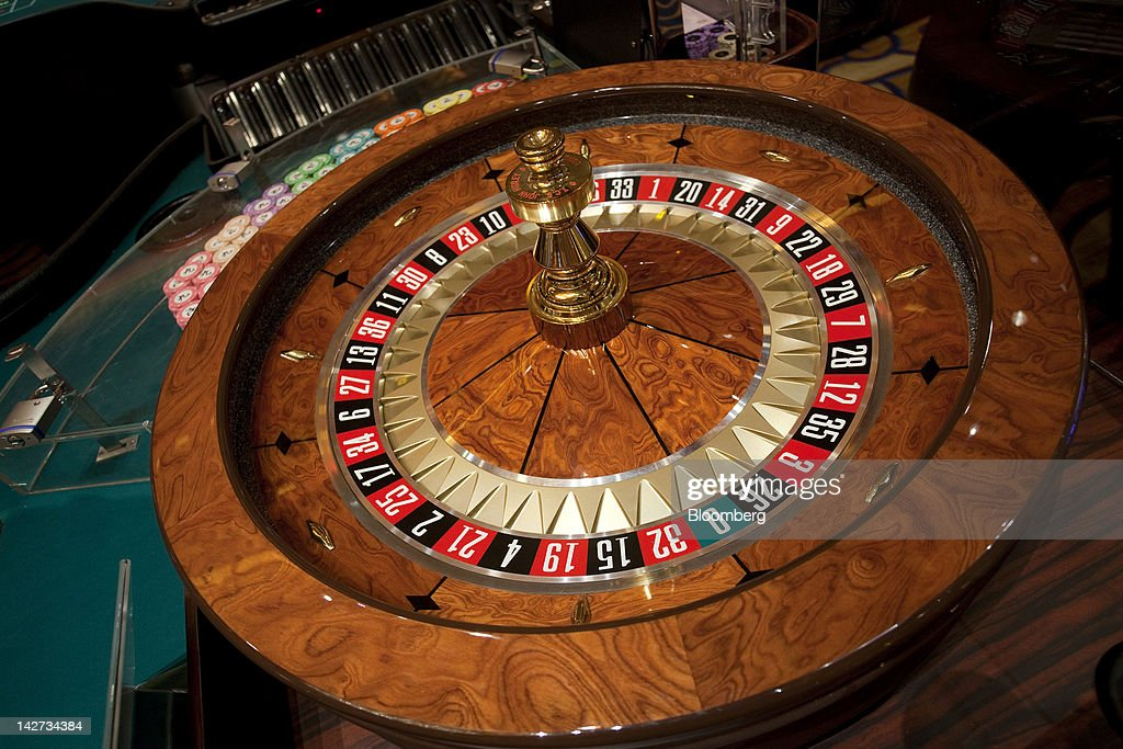 A roulette wheel sits in the Sands Cotai Central casino resort in Macau, China, on Wednesday, April 11, 2012. Las Vegas Sands Corp. Chairman Sheldon Adelson plans to spend $35 billion on building Spanish gambling resorts over nine years and will add a new Macau location to expand globally. Photographer: Jerome Favre/Bloomberg via Getty Images