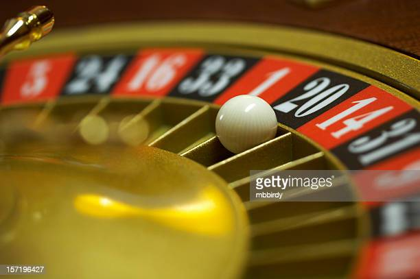 Roulette wheel with ball on number 20, close up