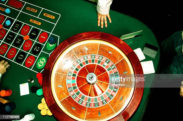 Roulette wheel with hand and table