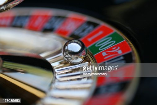 A roulette wheel with the ball on 00