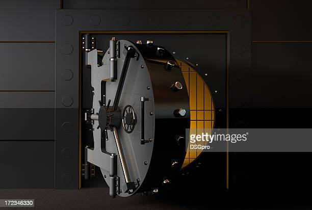 A round bank vault door slightly open