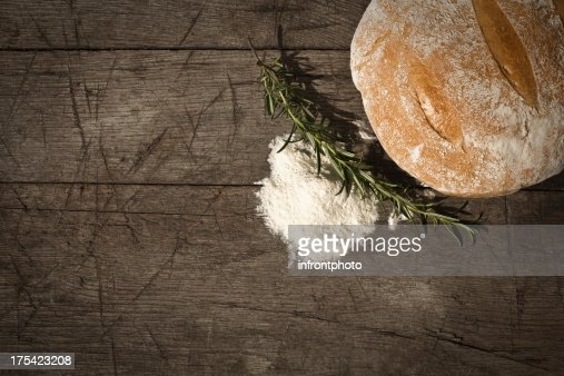 Round Bread On A Wooden Table