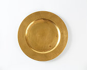 Round gold charger plate with wide rim
