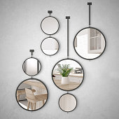 Round mirrors hanging on the wall reflecting interior design scene, minimalist white kitchen, modern architecture