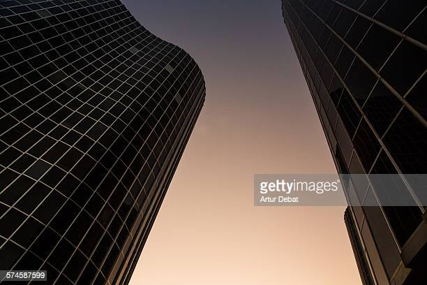 Round shaped skyscrapers architecture at dusk