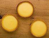 round vanilla tart on rustic wooden table