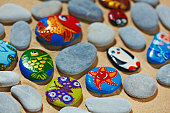 Rounded stones from sea vacation painted, souvenir made by kid