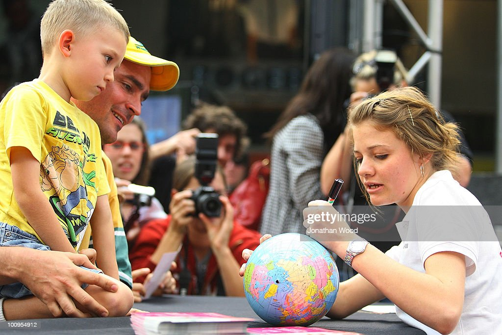 Round-the-world teen sailor Jessica Watson draws the path of her voyage on a globe for a young fan during a welcome home event at Queen Street Mall on May 26, 2010 in Brisbane, Australia. Watson, who turned 17 last week, returned to Australia to a hero's welcome on May 15 after sailing solo, non-stop and unassisted around the globe, completing the journey in 210 days.