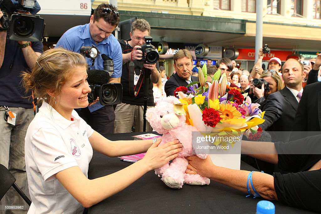 Round-the-world teen sailor Jessica Watson receives flowers from a well wisher during a welcome home event at Queen Street Mall on May 26, 2010 in Brisbane, Australia. Watson, who turned 17 last week, returned to Australia to a hero's welcome on May 15 after sailing solo, non-stop and unassisted around the globe, completing the journey in 210 days.