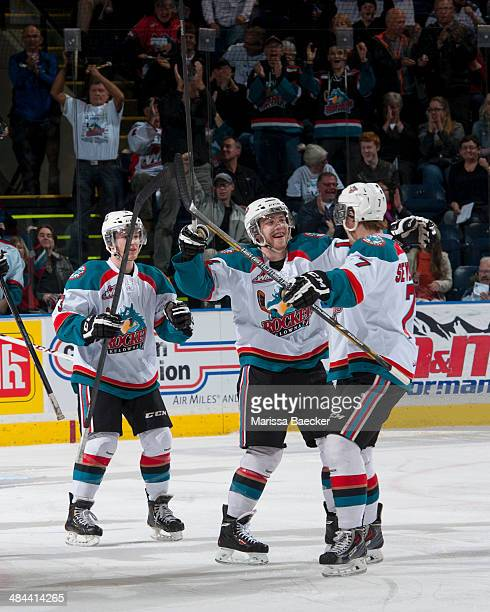 Rourke Chartier Riley Stadel and Damon Severson of the Kelowna Rockets celebrate a goal against the Seattle Thunderbirds on April 3 2014 during Game...