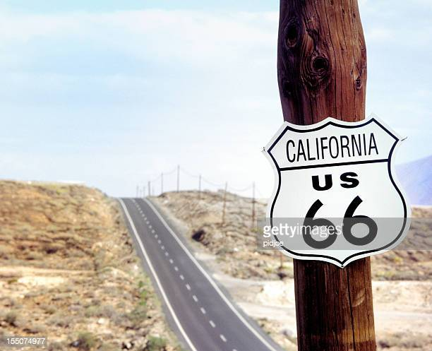 route 66 road sign on wooden pole