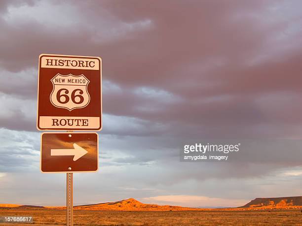 route 66 sign and desert sunset landscape