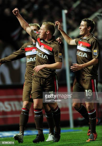 Rouwen Hennings celebrates after scoring his team's second gaol with team mate Max Kruse of StPauli during the Second Bundesliga match between FC St...