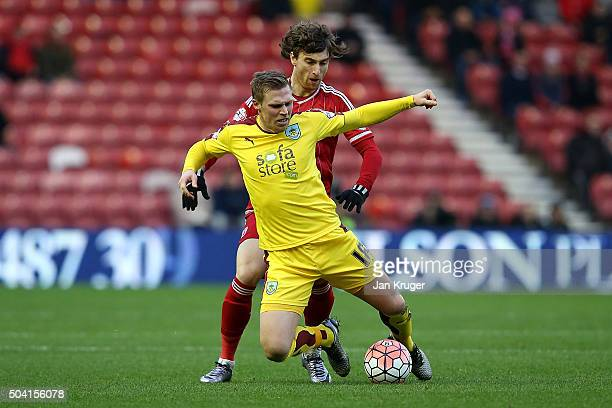 Rouwen Hennings of Burnley battles with Fernando Amorrebieta of Middlesbrough during the Emirates FA Cup third round match between Middlesbrough and...