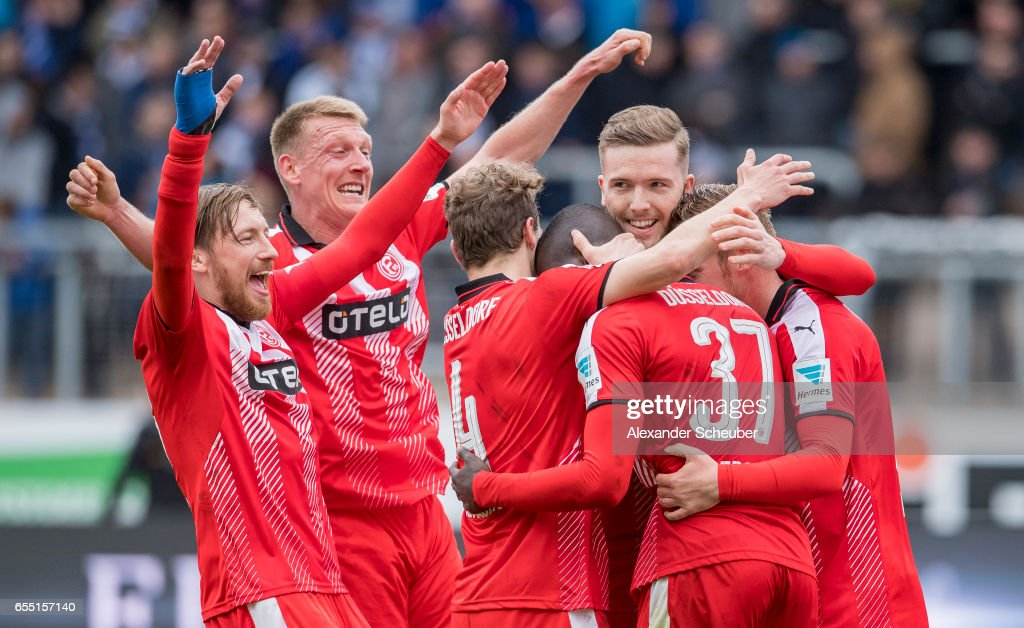 Rouwen Hennings of Fortuna Duesseldorf celebrates the third goal for his team with his teammates during the Second Bundesliga match between Karlsruher SC and Fortuna Duesseldorf at Wildparkstadion on March 19, 2017 in Karlsruhe, Germany.